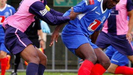 Cliff Akurang (blue) in action for former club Leiston