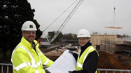 Mark Taylor, contracts manager at ISG, and Odran Doran, head teacher at the Bridge School, on the si