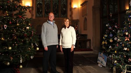 Christmas tree festival at St John's Church in Saxmundham. Rev Andy Wolton and Jill Sedge.