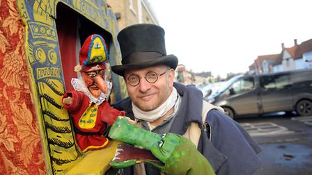 The Long Melford Christmas street fair. Stephen Abs Wisdom with his puppets.