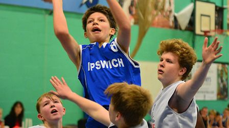 Ben Winter shoots in traffic for Ipswich basketball club