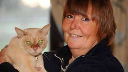 Bernie Ingram after being reunited with her missing cat