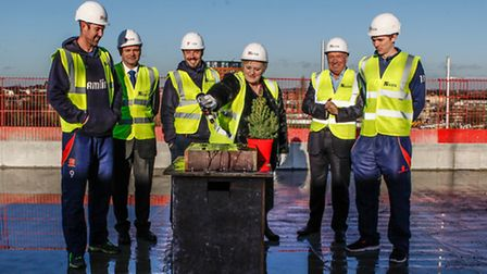 Chelmsford deputy mayor Sandra Pontin pours beer over the ceremonial slab, watched by (l-r) David Ma