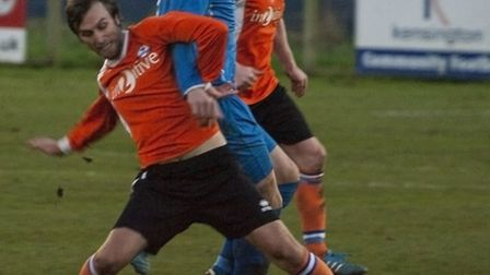 Brantham (blue shirts) V Yaxley in the FA Vase football competition at Brantham Leisure Centre. Phot