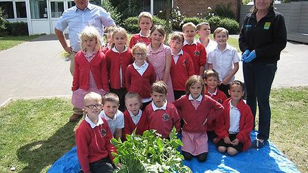 Monewden farmer Bruce Kerr gets involved in the Grow Your Own Potatoes campaign with local schoolchi