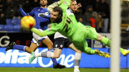 David McGoldrick watches his second half shot fizz across the goalmouth and wide at Bolton