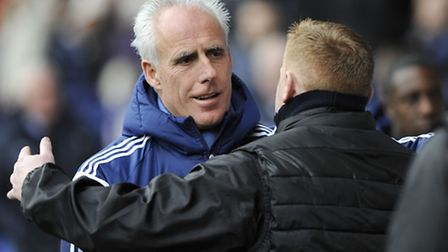 Mick McCarthy gets a hug from Bolton manager Neil Lennon before kick-off on Saturday. Photo: PAGEPIX
