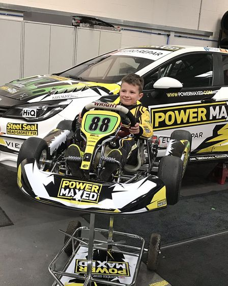 Logan Howes with his new Go karting suit and sticker kit at the Power Maxed factory.Picture: James H