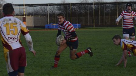 Tom Emery from St Joseph's College attacking with the ball during the win against Dartford Grammar i