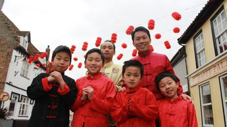 To celebrate the Chinese New Year in Diss, Happy Palace co-owners Hong Can Li (back left) and Neal L