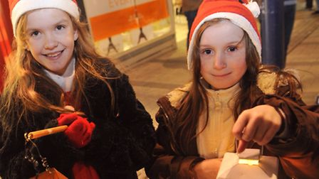Toni Wix, 9, and Jorja Pearson, 8, hold their lanterns in a procession at the Felixstowe Christmas T