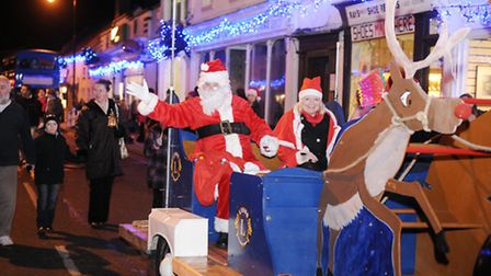 Christmas light switch on and street fayre in Saxmundham Santa is pictured here arriving in Saxmu