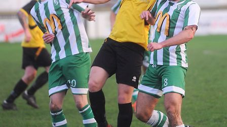 Miles Powell (left) in action for Whitton United against Stanway Rovers.