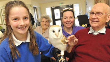 Pupil Ella with Loraine Precey and resident Raymond Cooper. Photo: Care UK