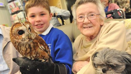 Pupil Kieran with resident Olive Andrews. Photo: Care UK