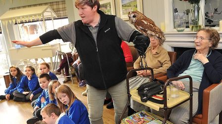 ZooTastic teach residents at Hartismere Place about the owls. Photo: Care UK