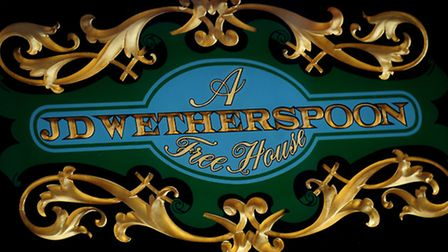 The JD Wetherspoon logo outside one of its pubs.