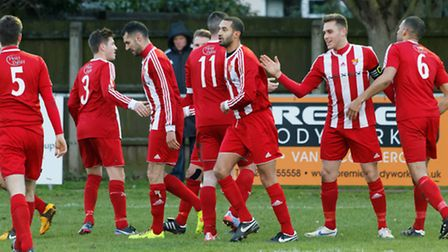 Seasiders' players celebrate with captain Ben Cranfield after his opening goal