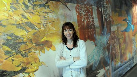 Artwork is unveiled at Sudbury Community Health Centre. Naomi McIlroy is pictured with her winning a