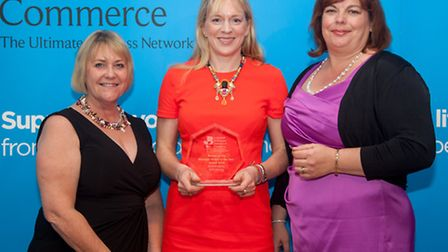 Erika Clegg of Spring, centre, receives the Business Person of the Year award from Nicola Corbett of