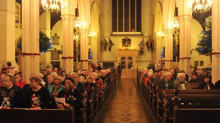 Members of the audience listen to the St Mary-Le-Tower Church Choir perform at the annual Concert of