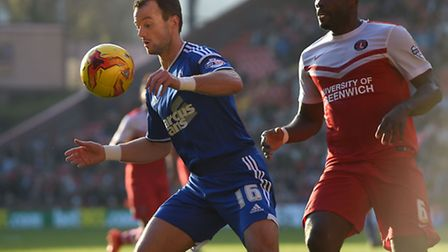 Noel Hunt shields the ball from Andre Bikey at Charlton