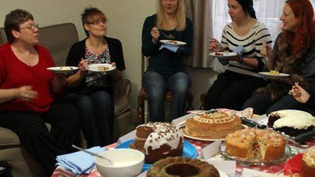 Members of the Clandestine Cake Club share tips about their creations. Photograph Simon Parker
