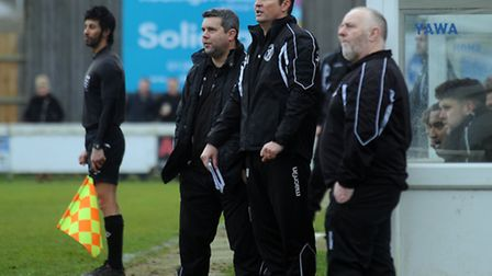 Leiston manager, Richard Wilkins (centre), watches on at Bury