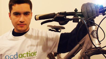 Cornard United assistant and OCD sufferer Jack Pridmore poses with his bike before his big week of a