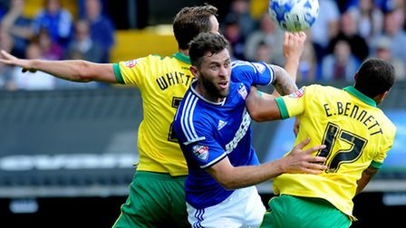 Ipswich Town entertain local rivals Norwich City at Portman Road. Daryl Murpht sandwiched between S
