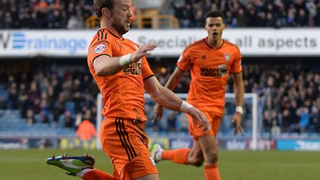 Noel Hunt slides into his celebration after scoring Ipswich's second at Millwall. Photo: PAGEPIX LTD