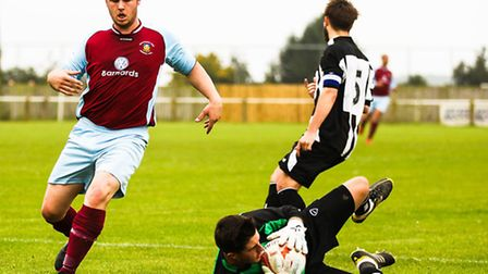 Chris Gray (claret), who has just signed for Mildenhall Town from Stowmarket Town