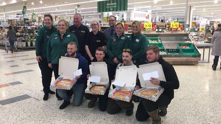 Morrisons in Diss gave giant cookies to the heroes who helped people out of the snow last week. Phot