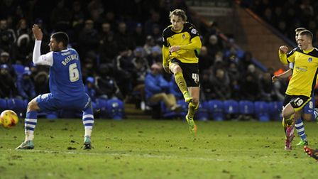 Elliott Hewitt lashes home Colchester's second goal at Peterborough with a powerful shot from outsid