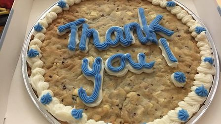 The snow heroes were thanked with a giant cookie, a free meal in the cafe and a few other items from