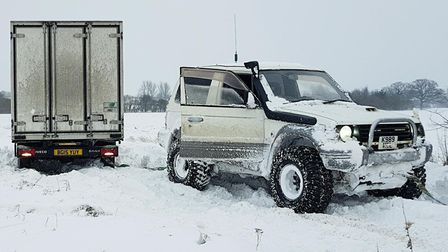 The group of men from villages around Diss used their 4x4s to haul lorries, cars and anyone else who