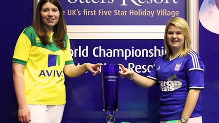 Rebecca Field (right) and Katherine Rednall holding the Ladies World Match Play trophy which is up f