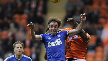 Stephen Hunt jumps for a long throw at Blackpool