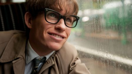 """This image released by Focus Features shows Eddie Redmayne as Stephen Hawking in a scene from """"The T"""