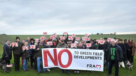 Protesters gathered in Fairfield Road in Framlingham to protest about the proposed housing developme