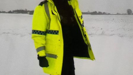A police officer pictured up to his knees in snow on the A140 on March 1. Picture: NORFOLK POLICE