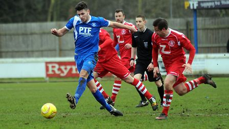Bury's Connor Hall (blue), has been a driving force for the Suffolk side in central midfield recentl