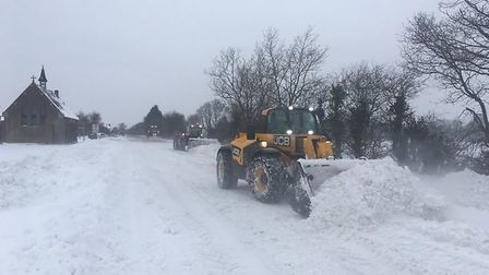 Farmers and businesses came together to clear the A140 of snow between Pulham Market (pictured) and