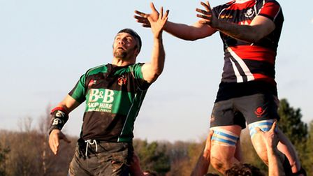 Stowmarket's Sam Cross is beaten in this line out by a Beccles opponent
