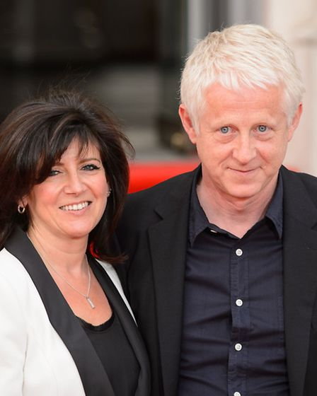 Director Richard Curtis and his wife Emma Freud arrive at the premiere of About Time at Somerset Hou