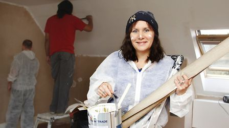 Rolling her sleeves up and getting on with the job of refurbishing Ufford Park's bedrooms is directo
