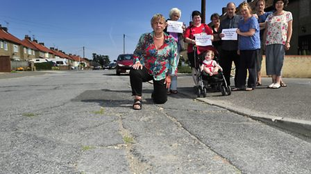 Users of Warwick Avenue, Woodbridge, campaigned against the state of the road surface with councillo