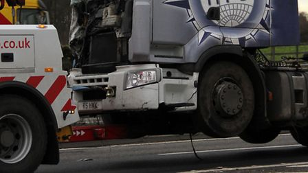 Recovery crews remove the lorry involved iin the crash on the A14 at Trimley. Photograph Simon Parke