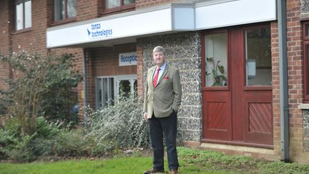Roger Skinner, businessman and pet food entrepreneur, in front of the Tenza building and land which
