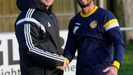Felixstowe managers Kevin ODonnell (left) shakes hands with Stanway boss Angelo Harrop before the g